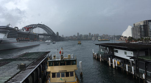 Thick storm clouds filled Sydney Harbour's skyline as commuters began the trip home this evening.