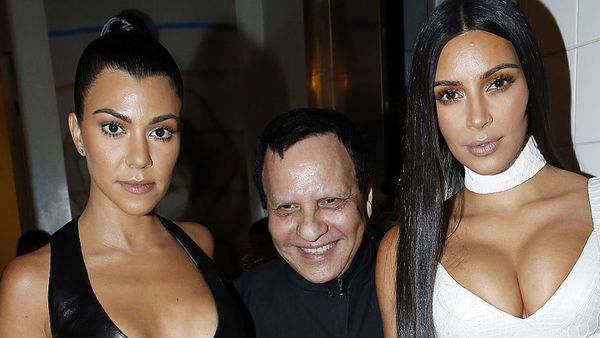 Kourtney and Kim Kardashian with Azzedine Alaia. Image: Getty