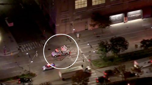 A vehicle, said to be used to transport bombs, carries away the suspicious package delivered to Robert De Niro's New York restaurant.