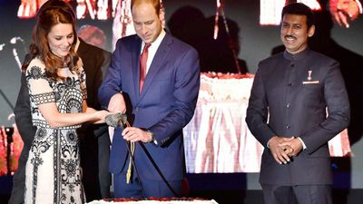 The royals cut a cake during 90th birthday celebrations for Queen Elizabeth II at the residence of the British High Commissioner in New Delhi, on day two of their tour.