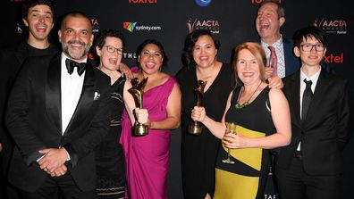 Deborah Mailman poses with the cast and crew of Total Control with the the AACTA Awards for Best Lead Actress and Best Drama Series in the media room during 2019 AACTA Awards Presented by Foxtel at The Star on December 04, 2019