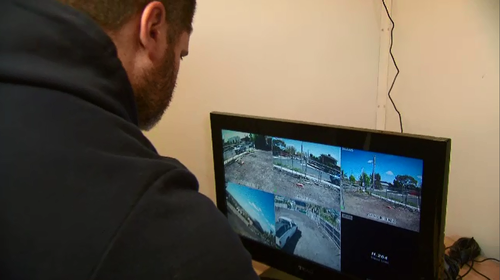 Robert Illoski monitors the security cameras on the property.