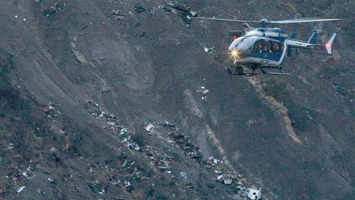Debris of the Germanwings passenger jet is scattered on the mountain side. (AAP)
