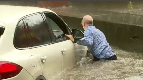 The helpless Porsche driver on the inundated Dudley Street.
