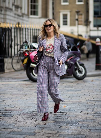 Lucy Williams updated her man-style suit with a rock god T-shirt and seriously stylish shades.