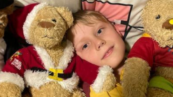 Eli with his Kids' Cancer Project bears