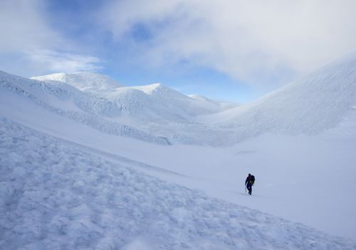 A lone figure walks through a snow covered peak on Marion Island, once of the most remote islands in the world.