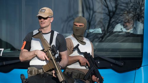 Armed police stand guard at the scene. (DPA)