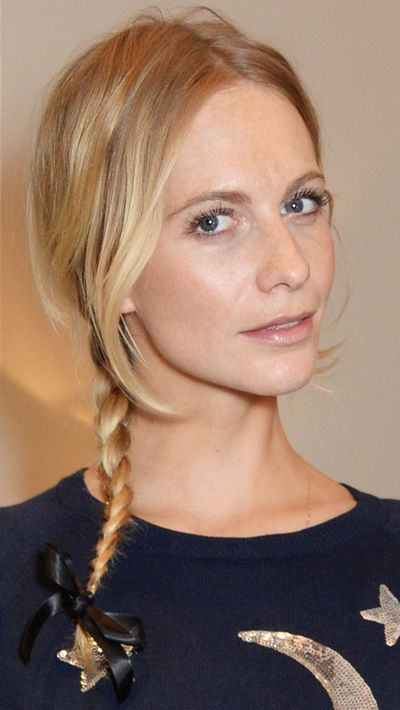 Brush a small amount of dry shampoo through the front of your hair, and plait the rest. Tuck the loose front strands behind your ears to give you a natural kink by the time you reach the office.