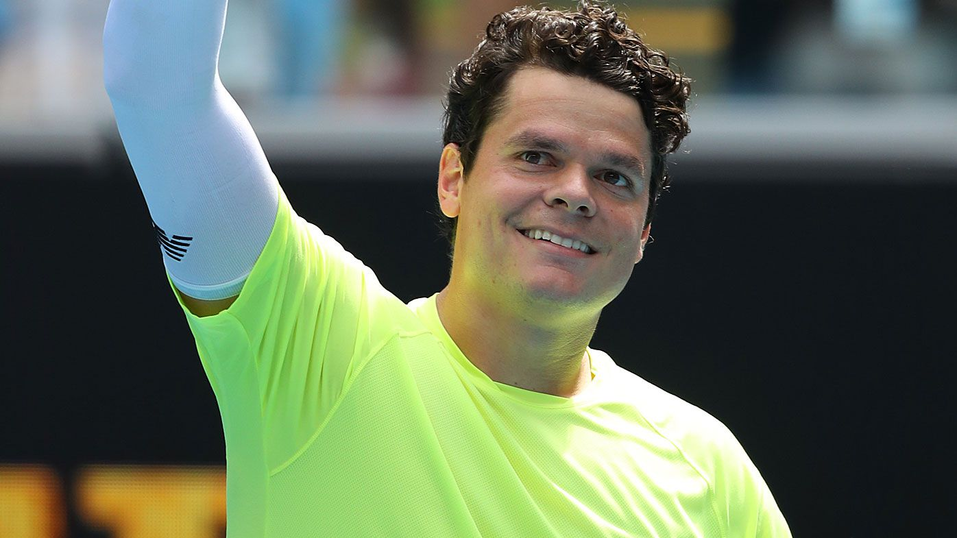 Milos Raonic of Canada celebrates after winning match point