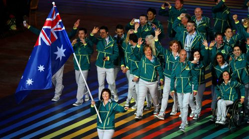 Australian Flag bearer and Cyclist Anna Meares leads the Australian athletes. (Getty Images)