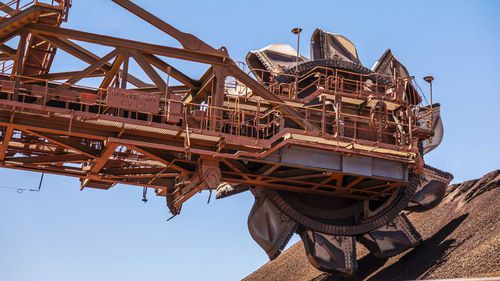 A reclaimer at the ore stockpile at the BHP Jimblebar facility in the Pilbara region of Western Australia.