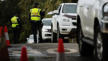 Commuters are stopped by police at the Queensland - NSW border checkpoint in the Gold Coast hinterland at Nerang Murwillumbah Road.