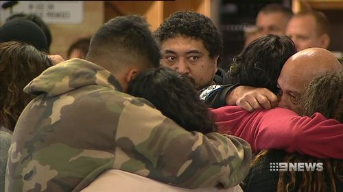 Attendees embraced at today's emotional vigil. Picture 9NEWS