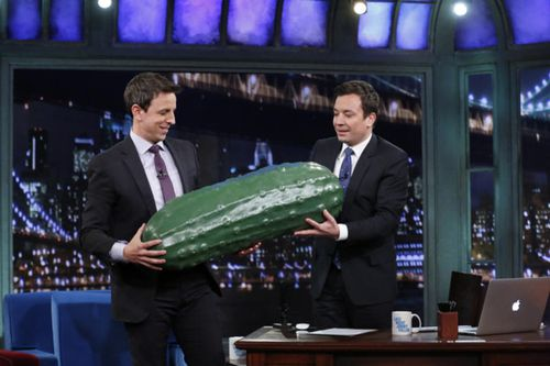 Seth Meyers and Jimmy Fallon manhandle a giant plastic pickle prop on NBC. Meyers will host the Emmys, at which Fallon will make a special appearance. Picture: AP