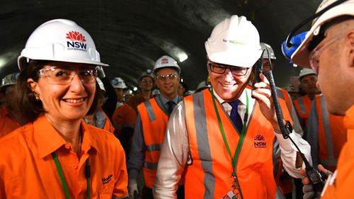 Then Prime Minister Malcolm Turnbull and NSW Premier Gladys Berejiklian give the go ahead for the first tunnel breakthrough of the NorthConnex project in West Pennant Hills in Sydney, December 2017. (AAP)