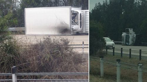 A truck and police car crashed on the Pacific Motorway. (Zak Redmond)