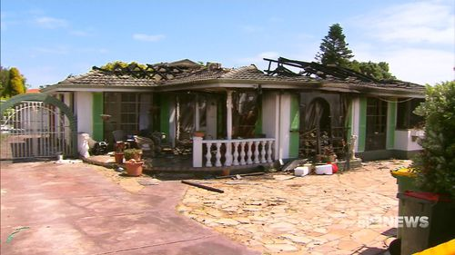 The young boy and his parents escaped the fire with one of their pet dogs, but the other perished inside the property. (9NEWS)