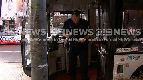 Police are talking to the bus driver. Picture: 9NEWS