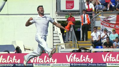 Mark Wood celebrates taking the wicket of Chris Rogers