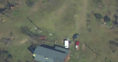 "April hand was able to send help to her family in Youngstown, Florida after spotting a ""help"" sign they spelled out on their lawn."