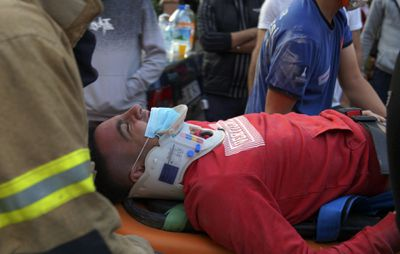 Rescuers evacuate the injured