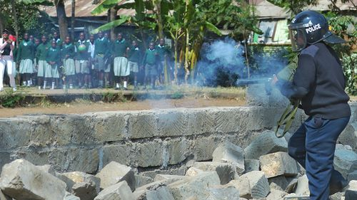 Police tear gas schoolchildren from the Lang'ata Road primary school. (Tony Karumba/AFP/Getty Images)