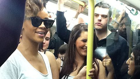 Rihanna catches the train with fans to her own concert