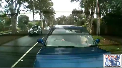 The girl's face can be seen hitting the dashboard of the vehicle. (Dash Cam Owners Australia)