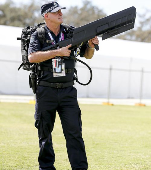 The DroneShield DroneGun MKII works by jamming the signal between a drone operator and the device itself, allowing police to safely bring it to the ground and stop it recording vision of the event or of venues from above. Picture: AAP.