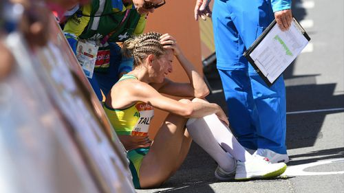 Claire Tallent is inconsolable after being disqualified from the race. (AAP)