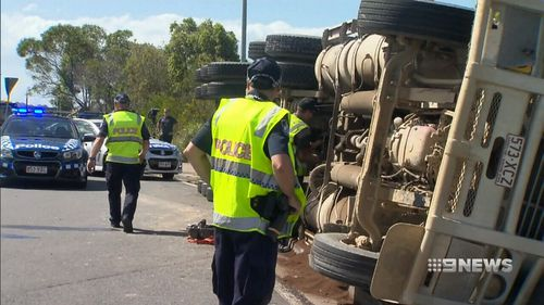 Steve Spencer was left dangling unconscious when his 46-tonne truck overturned on a Gold Coast roundabout (Supplied).