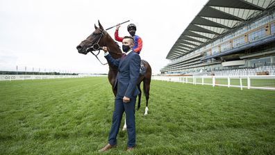 Jockey James Doyle celebrates after his victory on The Queens horse Tactical in The Windsor Castle Stakes and is held by his groom Nathan Cheshire during Day 2 of Royal Ascot at Ascot Racecourse on June 17, 2020 in Ascot, England.