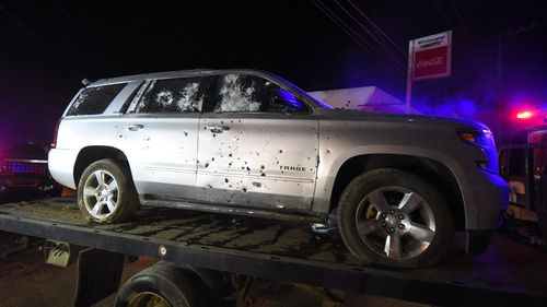 A bullet ridden sports utility vehicle is taken away by authorities after a gun battle with marines in which a man identified by authorities as the leader of the Beltran Leyva drug cartel in 2017.