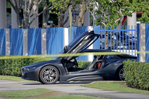 A BMW sits idle after XXXTentacion was shot in Deerfield Beach. The 20-year-old was shopping for a motorcycle when a gunman ran up to his vehicle and shot him. Picture: John McCall/South Florida Sun Sentinel/Getty Images