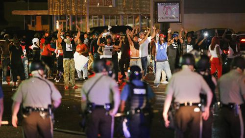 Demonstrators taunt police during a protest. (Photo by Scott Olson/Getty Images)
