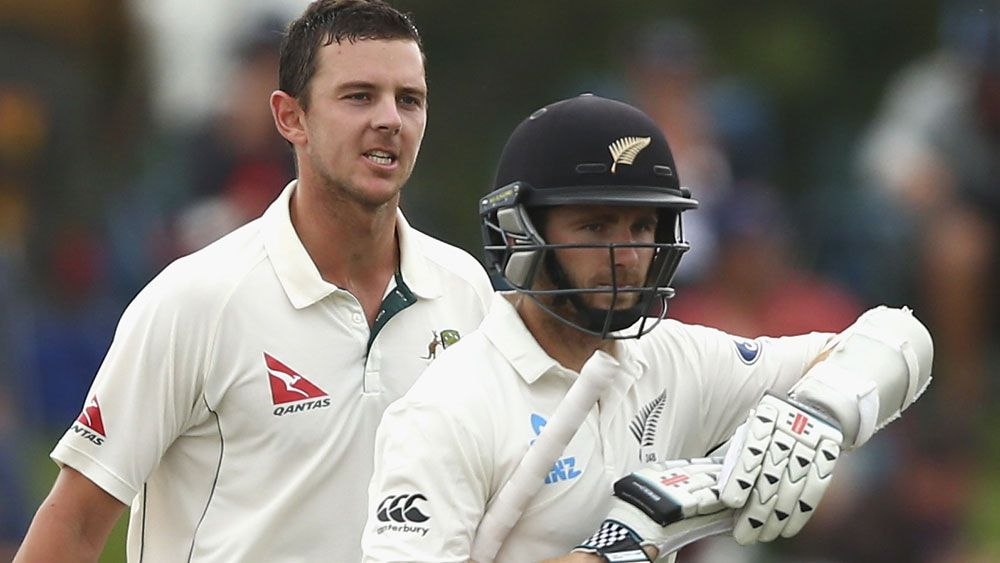 Hazlewood charged with dissent in Test