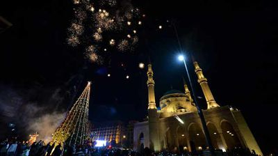 Fireworks over a giant Christmas tree in Beruit, Lebanon. (AAP)
