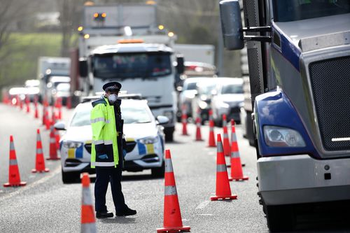 Queues stretch for kilometres in and out of Auckland as police stop vehicles at a checkpoint on SH1 north of Wellsford, which is situated north of Auckland.