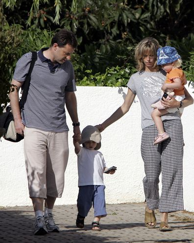Gerry and Kate McCann, the parents of the missing 3-year-old girl Madeleine McCann, walk with their twins outside their resort apartment on May 11 2007, in Praia da Luz, southern Portugal.