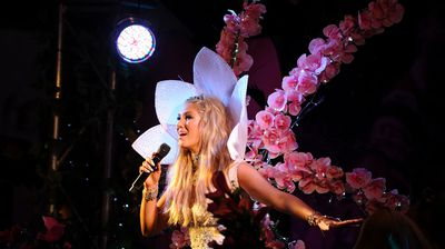 Pop starlet Delta Goodrem gets out in front of the floats saying it's 'my way of saying I support and love my friends' (AAP)
