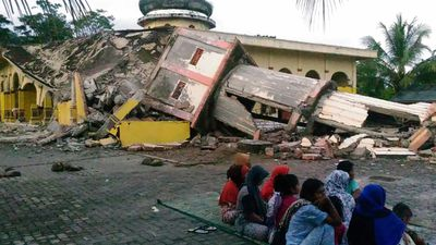 <p>A mosque minaret collapsed when the earthquake struck the town of Pidie in northern Sumatra. </p> <p>(AFP)</p>