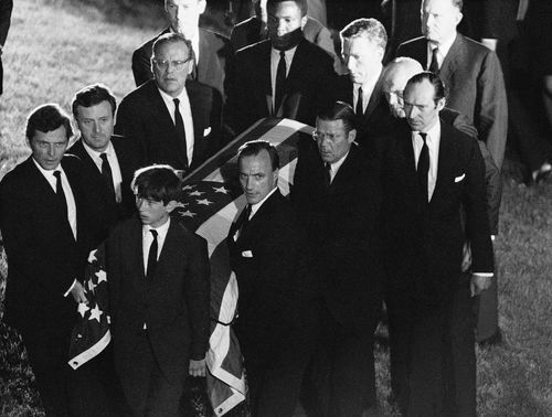 The casket of Robert F. Kennedy is carried to the grave site at Arlington National Cemetery, June 8, 1968
