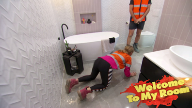 El'ise proves her tiles aren't slippery by attempting to glide across them