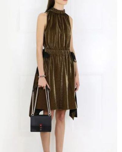 "Fendi lurex dress, $2175 at <a href=""https://www.parlourx.com/styles/dresses/lurex-jersey-dress-gold.html"" target=""_blank"">Parlour X<br /> </a>"