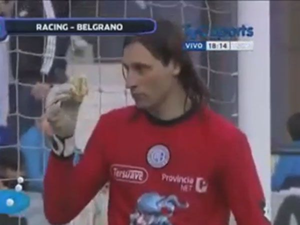 Keeper eats hamburger thrown from the stands