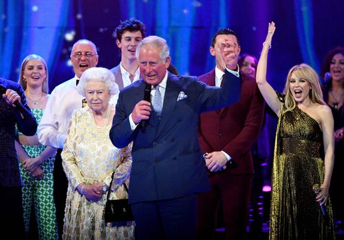 Queen Elizabeth II and Prince Charles onstage with Kylie Minogue at this year's The Diamond Jubilee Concert outside Buckingham Palace. Picture: PA