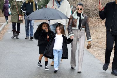 Reality TV star Kourtney Kardashian with her daughter Penelope and her niece North West in Central Park, New York, on February 4, 2018