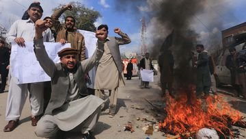 Protesters burn an effigy of Indian Prime Minister Narendra Modi in Peshawar, Pakistan.