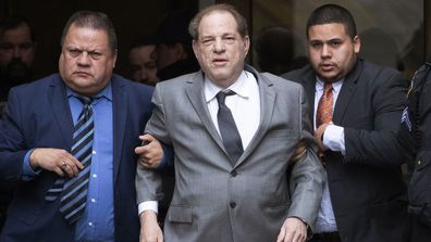 Harvey Weinstein, center, leaves court following a bail hearing, Friday, Dec. 6, 2019 in New York